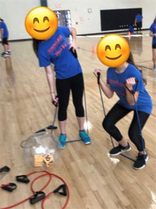 Children using exercise equipment at Northeast Junior High